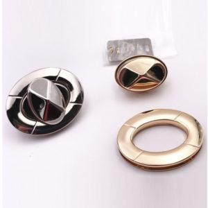 Chiusura L04 5,5 cm per borse disponibile in due differenti versioni: oro e argento.