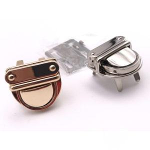Chiusura L10 3 cm per borse disponibile in due differenti versioni: oro e argento.