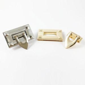 Chiusura M34 5cm per borse disponibile in due differenti versioni: oro e argento.